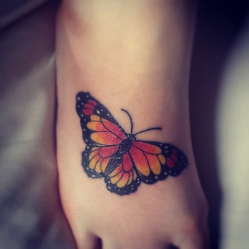 gorgeous-butterfly-tattoo-on-foot-for-girls