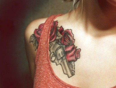 Gun and roses. Statement tattoo. Gun tattoo design
