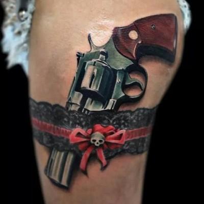 Gun behind the suspender belt tattoo idea. Girl with guns.